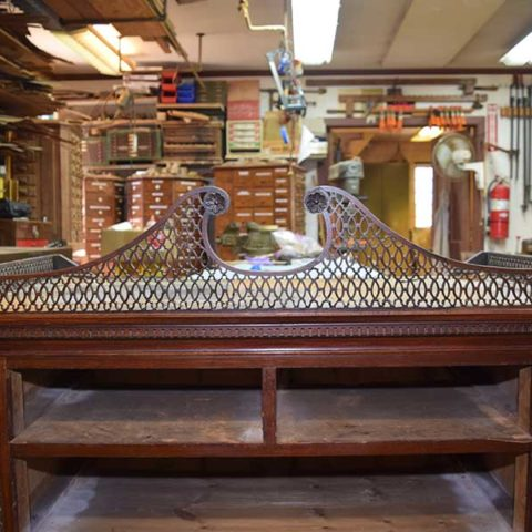 Repair and conservation services for antiques.